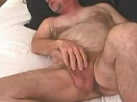 My own cock was dripping precum all over his legs and on the towel